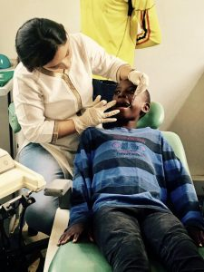 Dr. Roopa Bhandari, doing free dental check up for kids of Chances for Children Foundation, Kampala